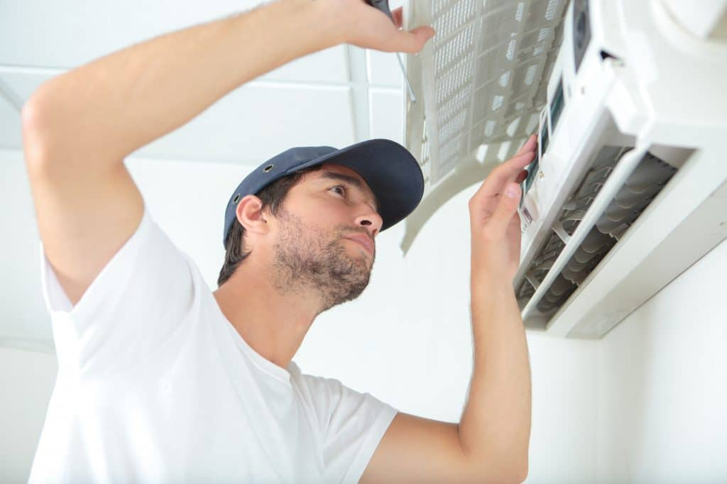 Aircon technician fixing aircon in PTA